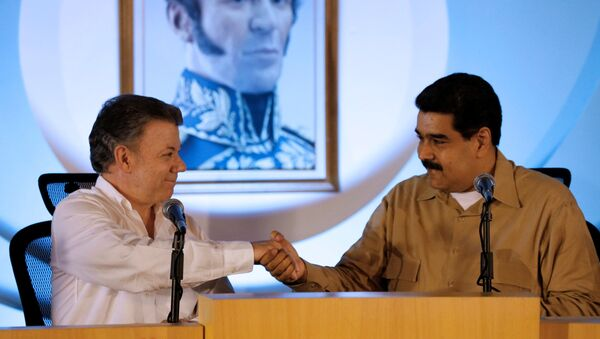 Presidente de Colombia, Juan Manuel Santos, y presidente de Venezuela, Nicolás Maduro - Sputnik Mundo