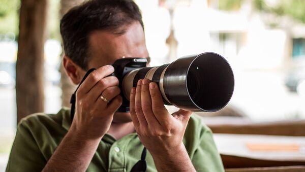 Un fotógrafo - Sputnik Mundo