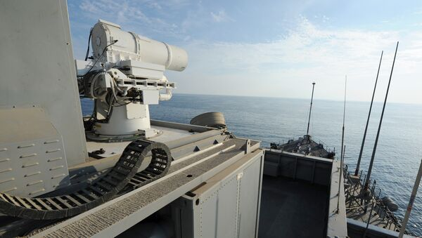 In this November 16, 2014 US Navy handout image the Afloat Forward Staging Base (Interim) USS Ponce (ASB(I) 15) conducts an operational demonstration of the Office of Naval Research (ONR)-sponsored Laser Weapon System (LaWS) while deployed to the Gulf. - Sputnik Mundo