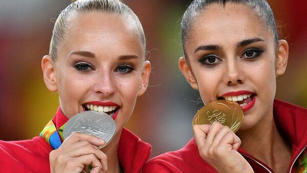 Призеры индивидуального многоборья в художественной гимнастике на XXXI летних Олимпийских играх - Sputnik Mundo