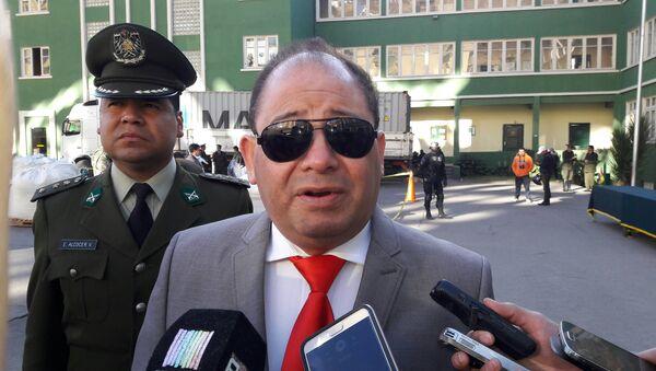 olivia's government minister Carlos Romero speaks during a news conference - Sputnik Mundo