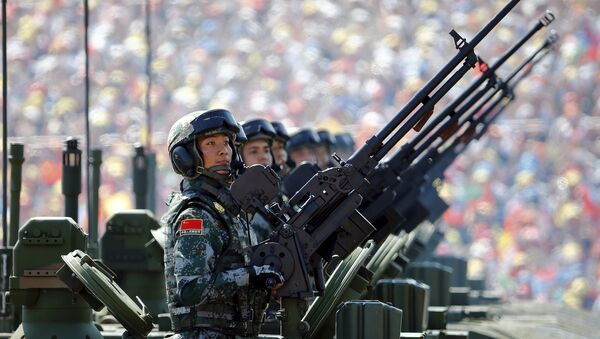Soldiers of the People's Liberation Army (PLA) of China arrive on their armoured vehicles at Tiananmen Square during the military parade marking the 70th anniversary of the end of World War Two, in Beijing, China, September 3, 2015 - Sputnik Mundo