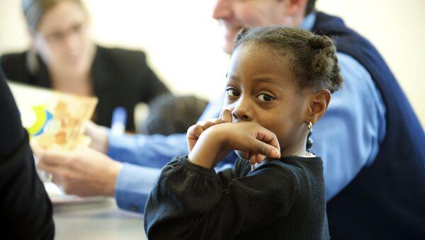 Niña afroamericana en una escuela de EEUU - Sputnik Mundo