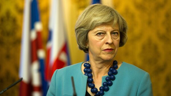 British Prime Minister Theresa May listens to journalists questions during a press conference after her meeting with Slovak Prime Minister, in Bratislava on July 28, 2016. - Sputnik Mundo