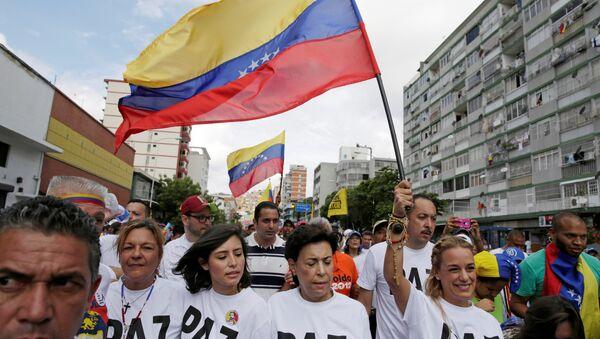 Una marcha de la oposición en Caracas, Venezuela - Sputnik Mundo