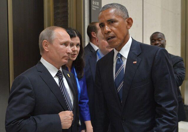 Presidente de Rusia, Vladímir Putin, con expresidente de EEUU, Barack Obama