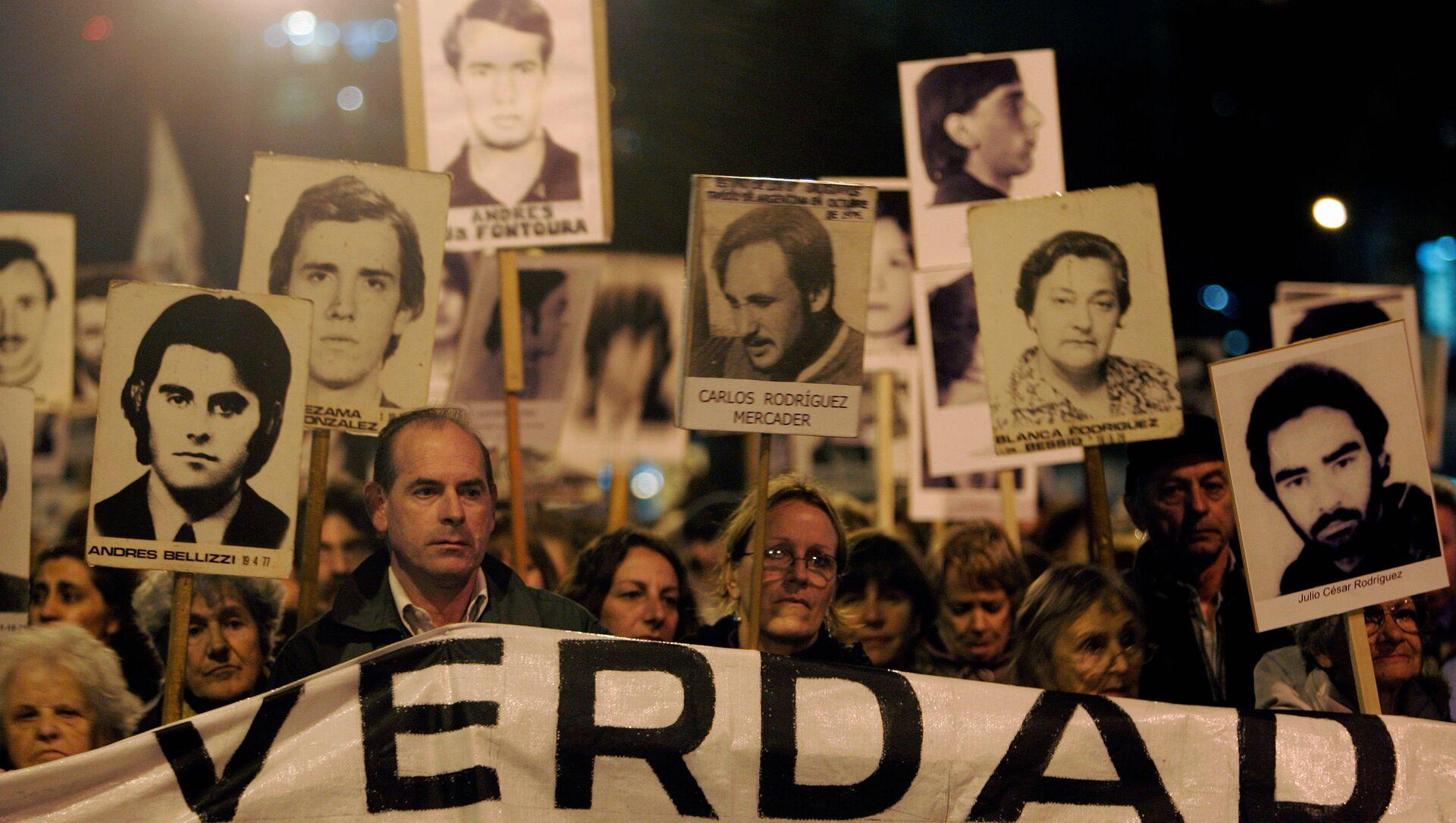 Marcha de Silencio en conmemoración de las víctimas de la dictadura de 1973-1985, 20 de mayo de 2088, Montevideo, Uruguay - Sputnik Mundo, 1920, 18.06.2019