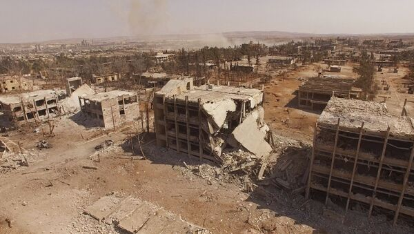 El edificio destrozado de la Escuela Aérea de Siria en Alepo - Sputnik Mundo