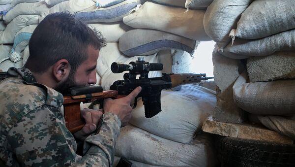 Un soldado del Ejército sirio - Sputnik Mundo