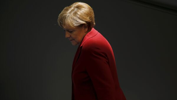 File photo of German Chancellor Angela Merkel attending a debate at the Bundestag, the lower house of parliament, in Berlin March 19, 2015 - Sputnik Mundo