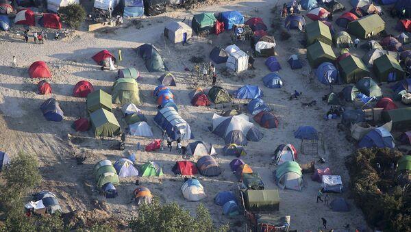 El campo de refugiados en Calais, Francia - Sputnik Mundo