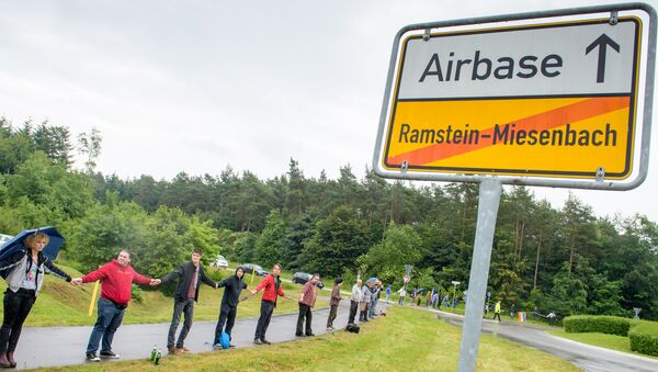 Activists attend a rally Stop-Ramstein on the road leading to US Air Force Base in Ramstein-Miesenbach on June 11, 2016 - Sputnik Mundo