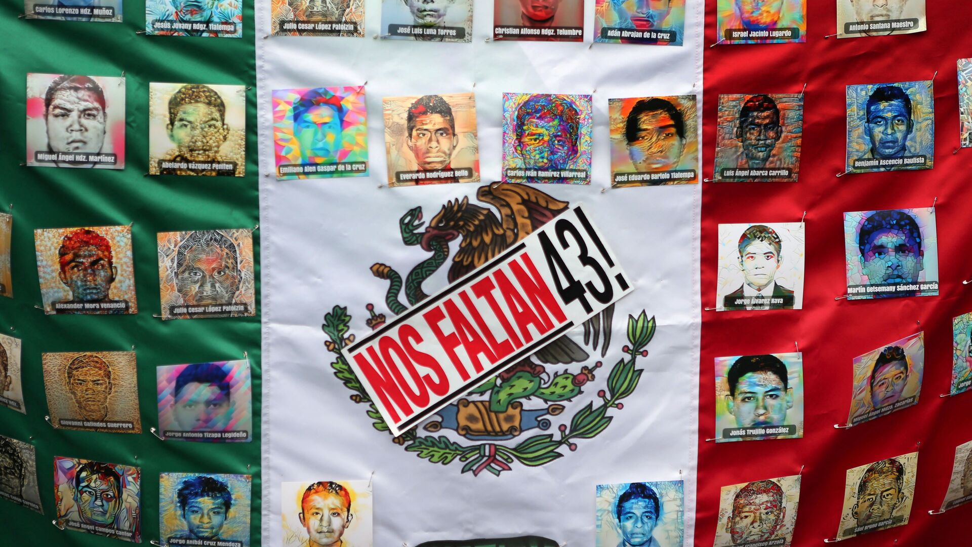 A Mexican flag and some pictures of the 43 missing students is seen in a march to demand justice for the 43 missing students of Ayotzinapa College Raul Isidro Burgos to mark the two-year anniversary of their disappearance in the state of Guerrero, in Mexico City, Mexico, September 26, 2016. - Sputnik Mundo, 1920, 15.06.2021