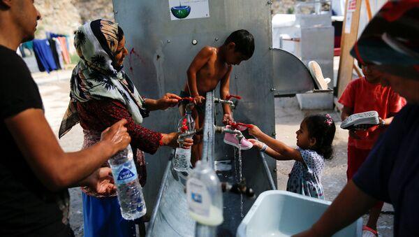 Refugiados sirios en Grecia - Sputnik Mundo
