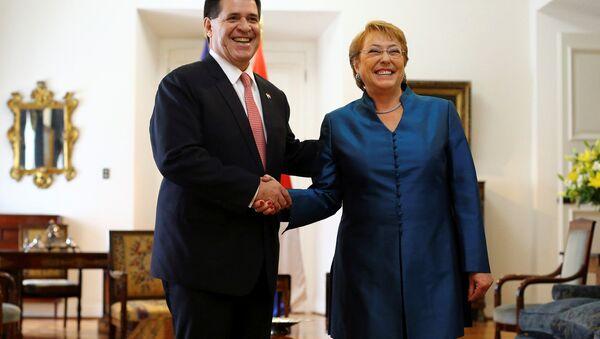 Michelle Bachelet, presidenta de Chile y Horacio Cartes, presidente de Paraguay - Sputnik Mundo