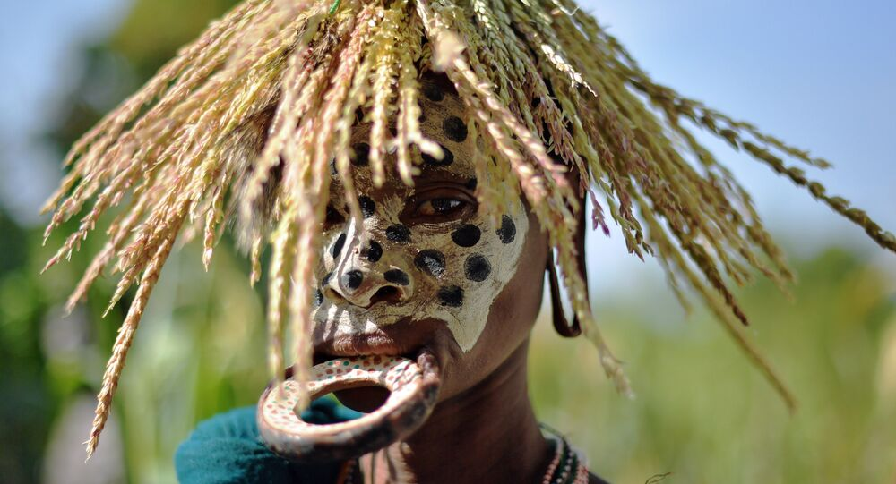 A woman from the Suri tribe with a lip plate poses in Ethiopia's southern Omo Valley region near Kibbish on September 25, 2016