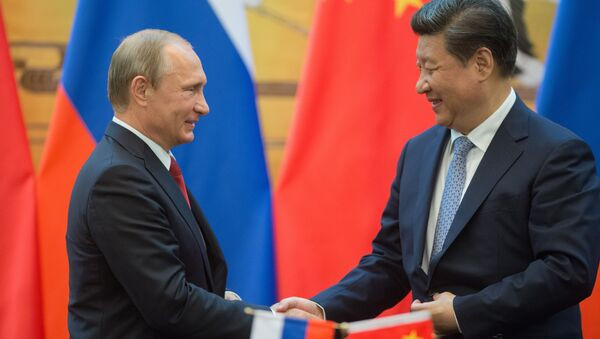 Vladímir Putin, presidente de Rusia, y Xi Jinping, presidente de China - Sputnik Mundo