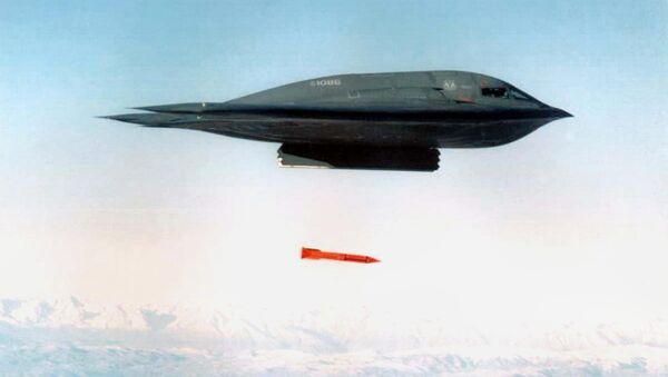 An undated file picture shows a B-2 Spirit Bomber droping a B61-11 bomb casing from an undisclosed location - Sputnik Mundo