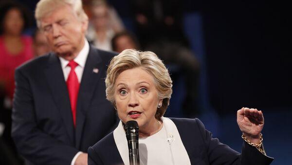 Donald Trump y Hillary Clinton - Sputnik Mundo