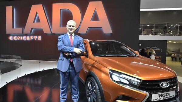 AvtoVAZ CEO French businessman Nicolas Maure poses in front of a Lada Vesta car - Sputnik Mundo