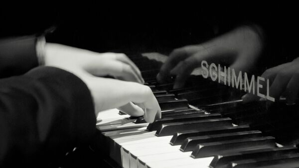 Un pianista - Sputnik Mundo