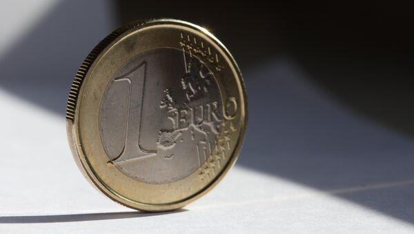 Una moneda de euro - Sputnik Mundo