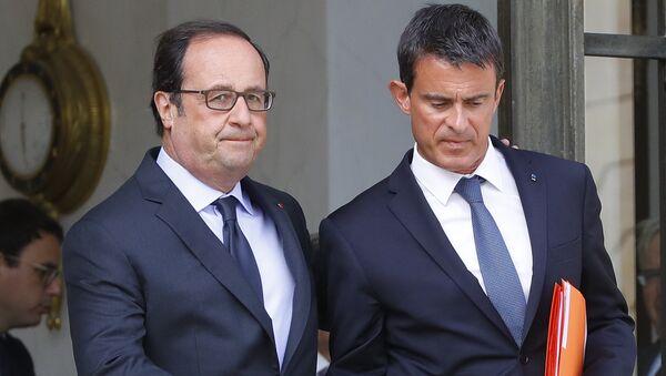 Francois Hollande y Manuel Valls - Sputnik Mundo