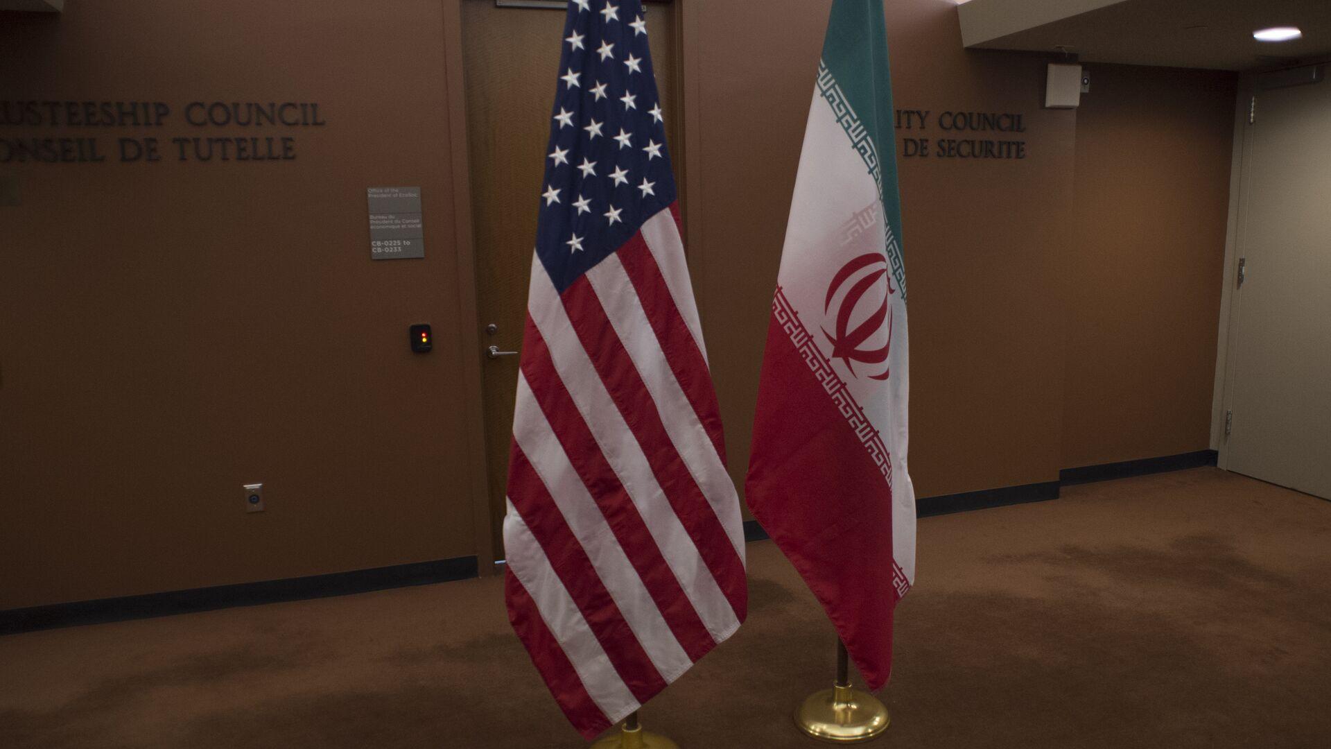 Banderas de EEUU e Irán - Sputnik Mundo, 1920, 05.04.2021