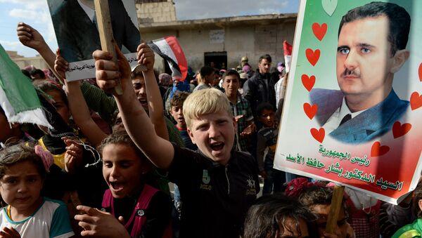 Partidarios de Bashar Asad en la ciudad de Hama - Sputnik Mundo