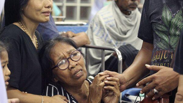 Familiares de las víctimas de la explosión en Tailandia - Sputnik Mundo