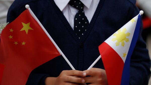 Las banderas de China y las Filipinas - Sputnik Mundo