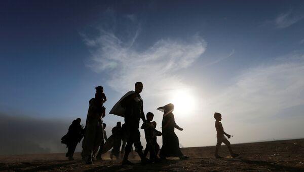 Civiles iraquíes (archivo) - Sputnik Mundo