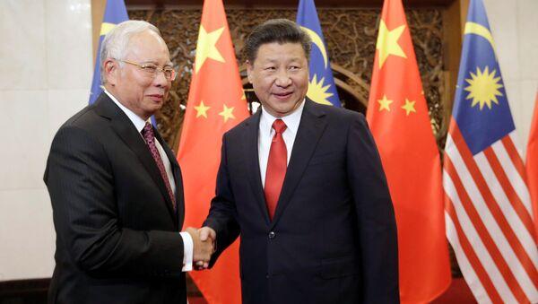 El primer ministro de Malasia, Najib Razak, y el presidente de China, Xi Jinping - Sputnik Mundo