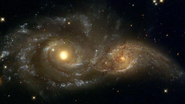 La fusión de las galaxias IC 2163 y NGC 2207 - Sputnik Mundo