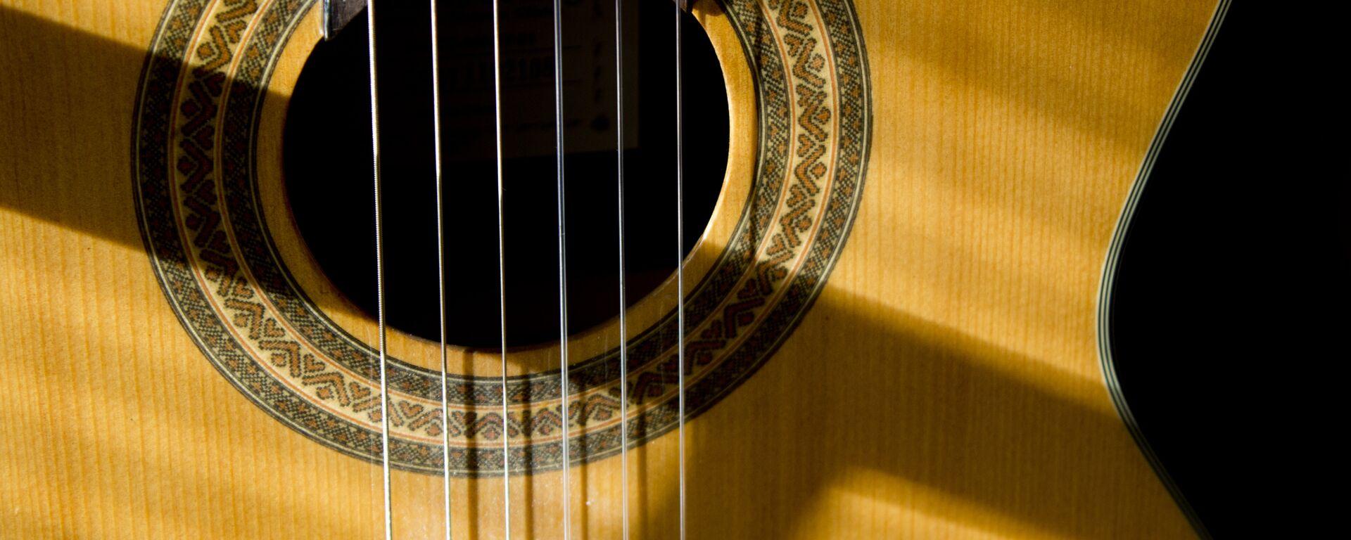 Una guitarra - Sputnik Mundo, 1920, 07.05.2021