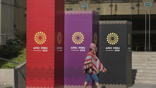A man dressed in traditional Andean clothes walks past the logo of the APEC 2016 summit in Lima, Peru, Wednesday, Nov. 16, 2016. - Sputnik Mundo