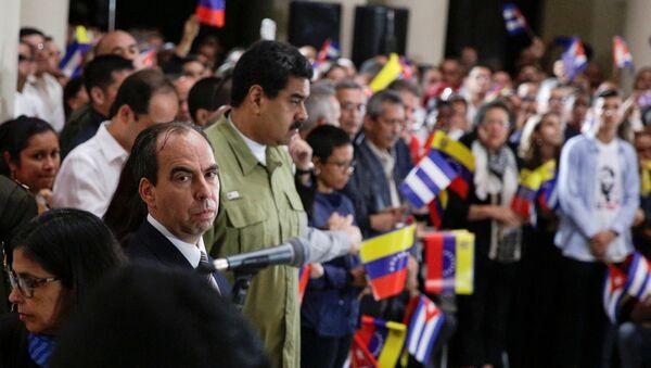 Rogelio Polanco y Nicolas Maduro - Sputnik Mundo