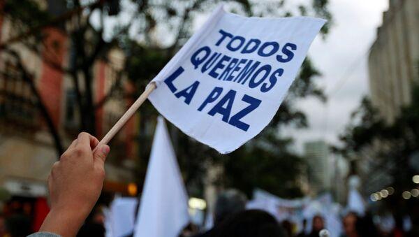 Una manifestación en apoyo de la firma del nuevo acuerdo de paz entre el Gobierno de Colombia y las FARC - Sputnik Mundo