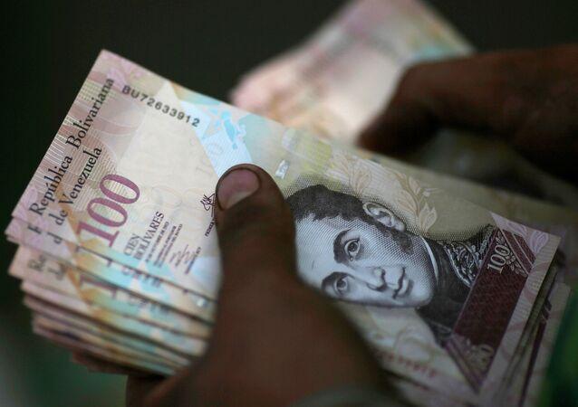 Billetes de 100 bolívares (imagen referencial)