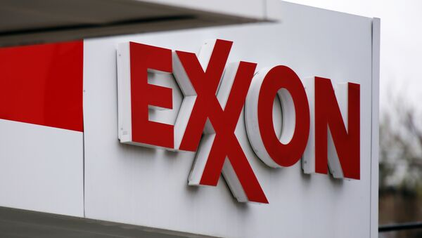 FILE - This April 29, 2014, file photo, shows an Exxon sign at an Exxon gas station in Carnegie, Pa. Low oil prices have helped cost Exxon its pristine AAA credit rating from Standard & Poor's, a label it held for over six decades, S&P announced Tuesday, April 26, 2016. - Sputnik Mundo
