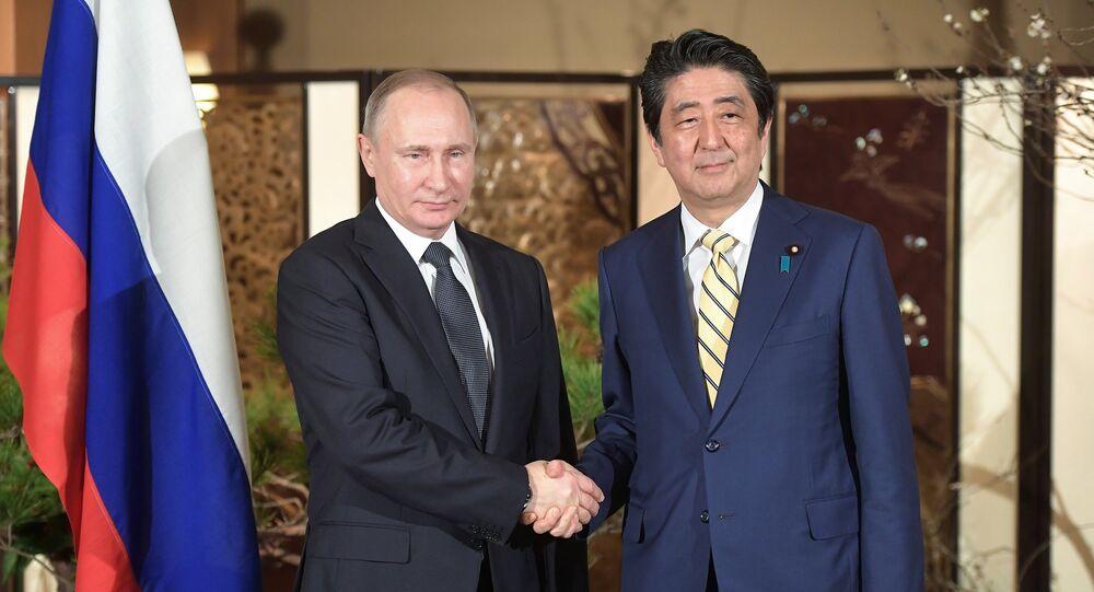 El presidente ruso, Vladímir Putin, y el primer ministro de Japón, Shinzo Abe