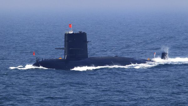 In this April 26, 2012 file photo released by China's Xinhua News Agency, Chinese navy's submarine attends the fleet review of the China-Russia joint naval exercise in the Yellow Sea - Sputnik Mundo