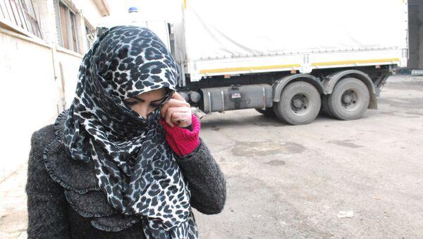 Una víctima de terroristas en Alepo - Sputnik Mundo