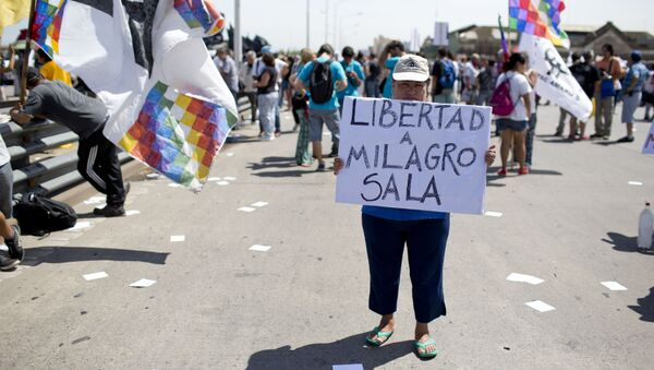 A demonstrator holds a banner reading in Spanish Freedom for Milagro Sala - Sputnik Mundo