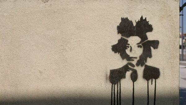 Un grafiti con el retrato de Basquiat - Sputnik Mundo