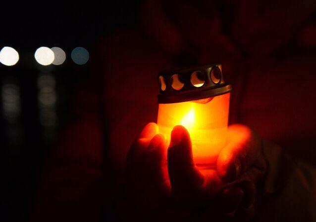 Una vela encendida (imagen referencial)