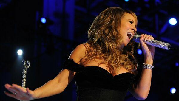 Mariah Carey en una presentación - Sputnik Mundo
