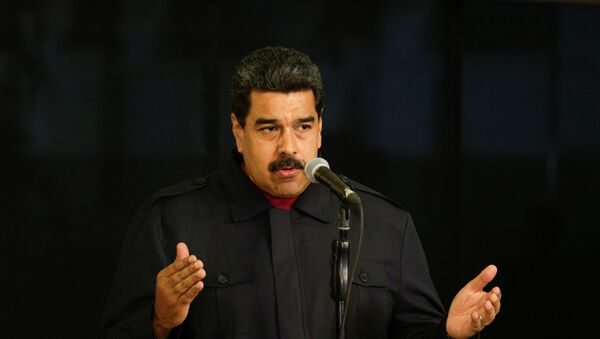 Venezuela's President Nicolas Maduro talks to the media during a news conference at Miraflores Palace in Caracas, Venezuela - Sputnik Mundo