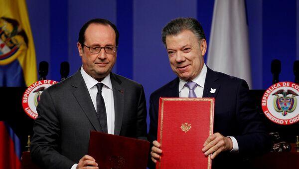 Francois Hollande, presidente de Francia, y Juan Manuel Santos, presidente  de Colombia - Sputnik Mundo