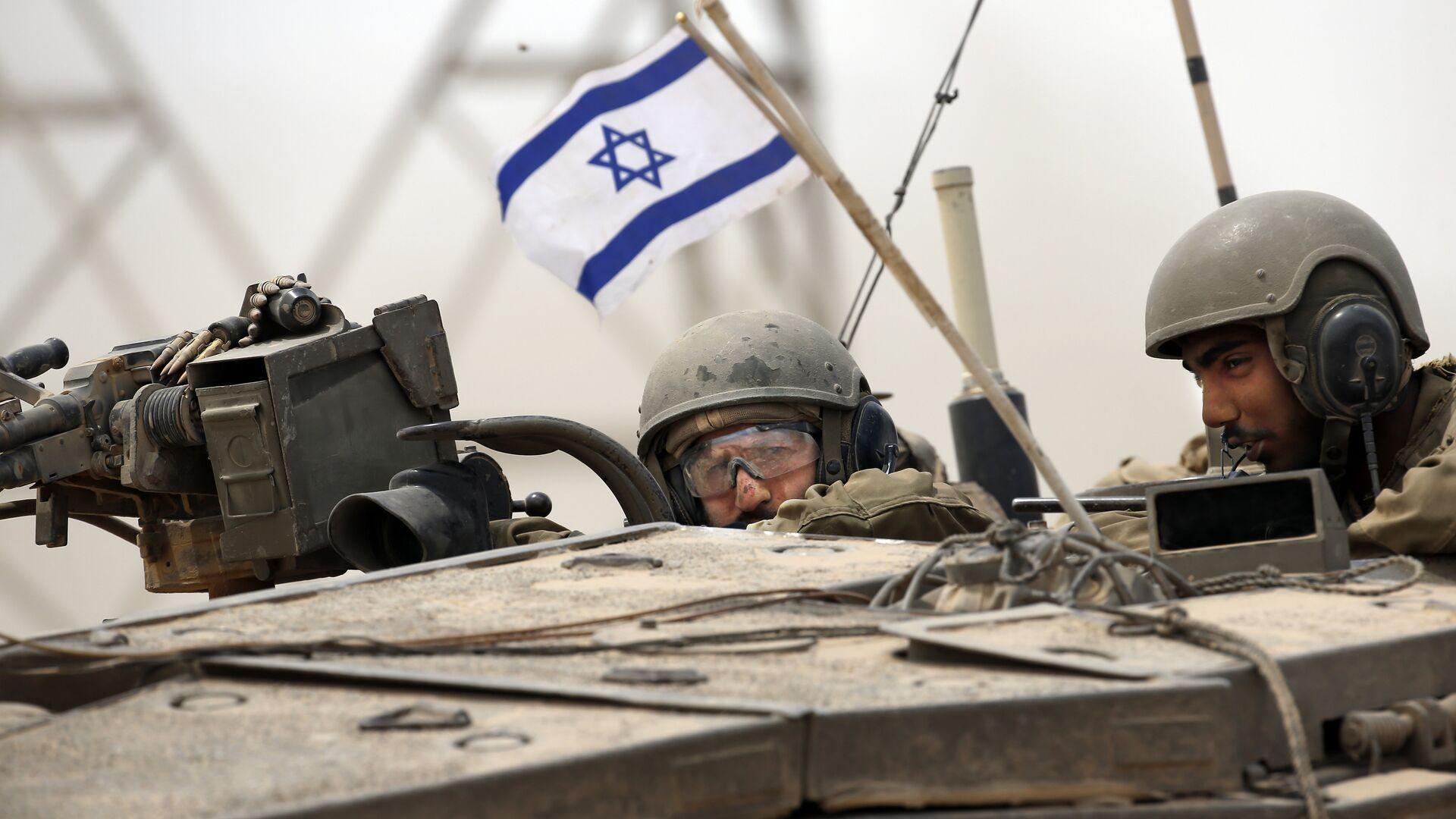 Soldados del Ejército israelí en un tanque Markava - Sputnik Mundo, 1920, 18.05.2021